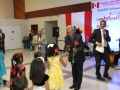 Aburaki welcomed to Ottawa concert with flowers from SCAO little angels