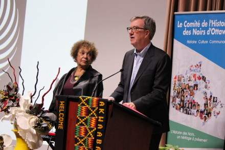 Mayor Jim Watson reads the Black History Month proclamation, with BHO Acting President June Girvan