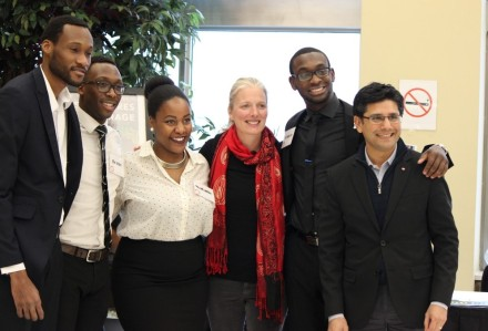 MP Catherine McKenna, centre, MPP Yasir Naqvi, right with Eldon Holder Jr and members of Young Leaders' Advisory Council