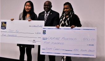 RBC Black History Month essay  contest winners Joy Xu , left, and Lauryne Muezelo with RBC Managaer Christopher Mayema-Panda, centre, at the Black History Month launch 28 January