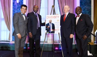 Dr. Peter Ozemoyah, President, Canadian Nuclear Society is named Person Of The Year; flanked by Ajay Tandon and Dr. Tony Ruprecht, Directors at the Transformation Institute, and Moses A. Mawa, President & CEO of Silvertrust Media and the Transformation Institut