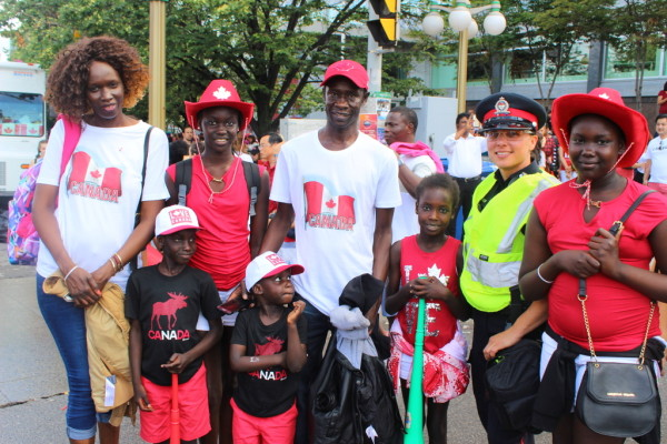 African Canadians pose with friendly Police Officer