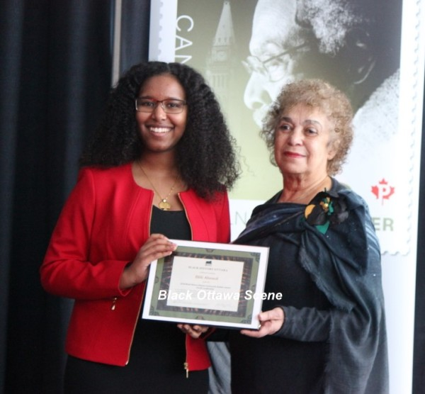 Ililli Ahmed proudly displays her award with June Girvan, Acting President Black History Ottawa